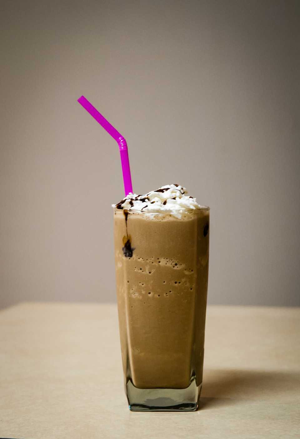 Cold coffee with a straw